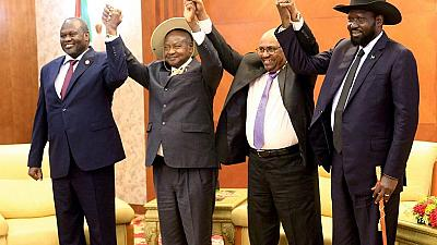 South Sudan's warring parties sign peace deal to share power