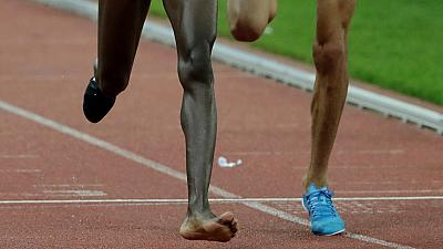 Photos: Shoe off, no problem: Kenyan athlete wins race with one shoe