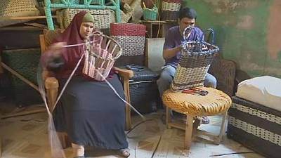 Visually impaired Egyptian couple making a living from weaving bamboo