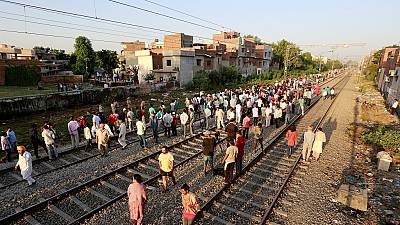 At least 59 killed as train hits crowd in northern India