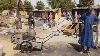 Nigeria villagers inspect ruins after Boko Haram attack