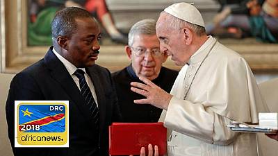 Pope hopes for peace as Congolese await poll results, EU cuts staff
