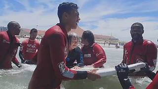 South Africa: physically challenged persons learning to surf