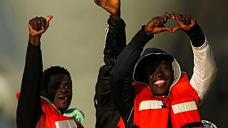 Stranded migrants on German rescue ship arrive in Italy
