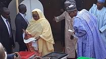 Photo: Buhari inspects who his wife voted for, Twitter reacts