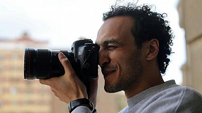 Freed Egypt photojournalist to spend nights at police for next 5 years