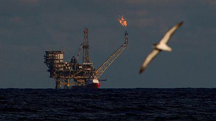 Oil stocks slide