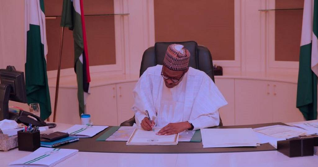 Win for Nigerian workers as Buhari signs law to increase minimum