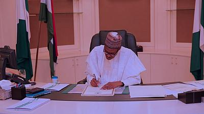 Win for Nigerian workers as Buhari signs law to increase minimum wage