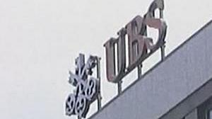 UBS slashes more jobs on subprime losses