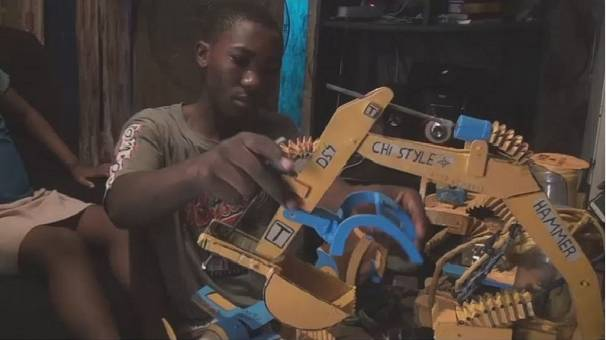Cameroon's amateur child engineer build miniature bulldozers from recycled materials