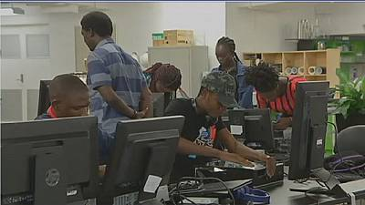 African migrants learn how to build computers in Australia