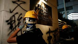 Hong Kong police slash with protesters in fresh demos