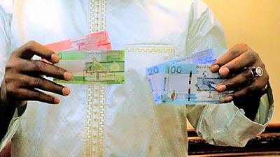 Gambia outdoors new banknotes without Jammeh's portrait