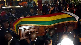 Photos: Stampede, tears as Zimbabweans flock Mugabe's funeral