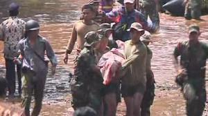 Dozens drown as Indonesian dam bursts