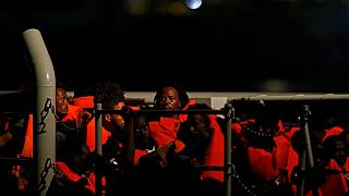 Scores of rescued migrants off Libyan coast flee