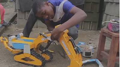 Displaced Cameroonian boy builds remote-controlled toys