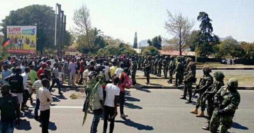 Four Malawi protesters charged over stoning policeman to death