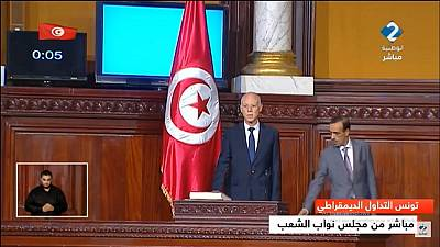 Tunisia's new president takes office, vows to protect women rights