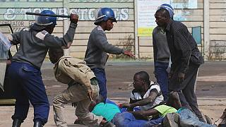 Zimbabwe police tear gas, batter opposition protesters
