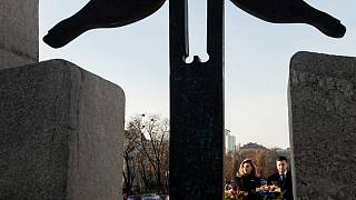 Ukrainian President Volodymyr Zelenskiy and his wife Olena visit a monument to Holodomor victims in Kyiv