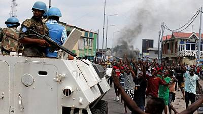 DR Congo protesters burn mayor's office in reprisal to rebel attacks