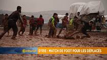 Displaced Syrians enjoy a game of football in jihadist-run region [Grand Angle]