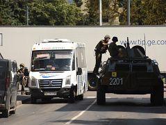 Ukrainian servicemen are seen at the scene where a man has taken 13 hostage on a bus in western Ukrainian city of Lutsk. July 21, 2020