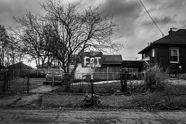 A basketball net supported by cinder blocks stands beside a street in Flint. The board reads 'FDT', an acronym based on a popular anti-Donald Trump protest song. February 25