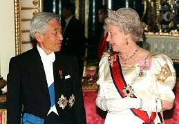 With Britain's Queen Elizabeth II at Buckingham Palace - 1998