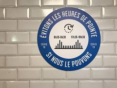 The stickers in Paris metro reminds the passengers to avoid using public transport during the peak hours. France. May 2020