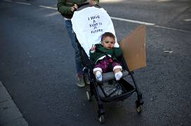 A person pushes a baby-troller with a slogan on it during a climate change demonstration in London, Britain, September 20, 2019.