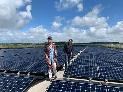 URGENDA director Marjan Minnesma and renewable energy entrepreneur Nicol Schermer inspecting floating solar cells on a water reservoir on the Dutch island of Texel
