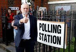 Britain's Labour Party leader Jeremy Corbyn gestures after voting