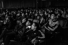 Young people watch a football match, screened at the Olympia cinema in Algiers, Algeria, on 16 March 2016. The cinema broadcasts European matches several times a week.