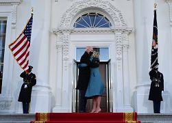 US President Joe Biden (C L) hugs First Lady Jill Biden as they arrive at the White House in Washington, DC. January 20, 2021