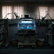A baby born a few hours earlier lies inside an incubator at Al-Shifa Hospital, Gaza