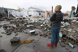 Faith Patton looks over buildings destroyed by storms in Nashville, Tennessee.