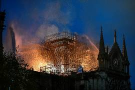 Flames are doused through the scaffolding erected on the roof of the Notre-Dame de Paris Cathedral after a fire broke out on April 15, 2019, Paris, France