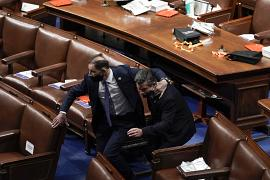 Lawmakers evacuate the floor as protesters were about to break into the House Chamber at the U.S. Capitol in Washington. January 6, 2021