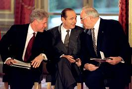 U.S. President Bill Clinton, French President Jacques Chirac and German Chancellor Helmut Kohl speak together as they attend the signing of the Bosnian peace agreement at the