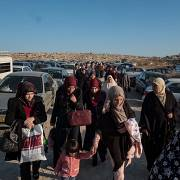 Wives, mothers, and children of Palestinian prisoners reach a checkpoint in Beit Seira, Palestine, on 26 November 2017