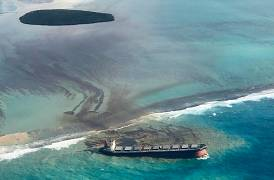 An aerial photograph taken on August 6, 2020 shows a large amount of oil near the vessel MV Wakashio, that ran aground near Blue Bay Marine Park off the coast of south-east Ma