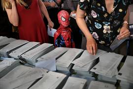 Spiderman stands next to ballots for EU election in Madrid