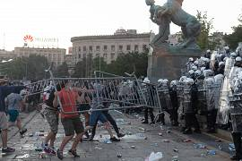 Protesters throw barricades at riot police in Belgrade, Serbia. July 8, 2020