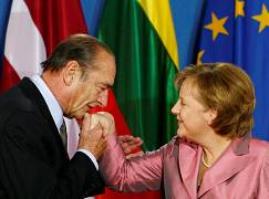 German Chancellor Angela Merkel (R) is kissed by French PresJacques Chirac (L) as she welcomes him at the Philharmonie in Berlin, Germany, March 24, 2007.