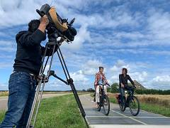 Camera-operator Martin Egter van Wissekerke filming URGENDA director Marjan Minnesma and renewable energy entrepreneur Nicol Schermer on the sunny Dutch island of Texel