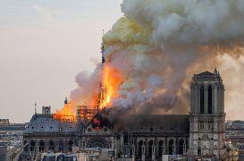 Smoke billows as flames burn through the roof of the Notre-Dame de Paris Cathedral, Paris, France. 15 April 15, 2019