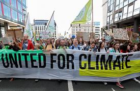 People take part in a demonstration claiming for urgent measures to combat climate change, in central Brussels, Belgium, September 20, 2019.